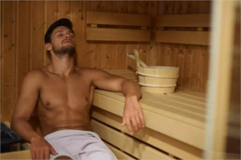 man in far infrared sauna room