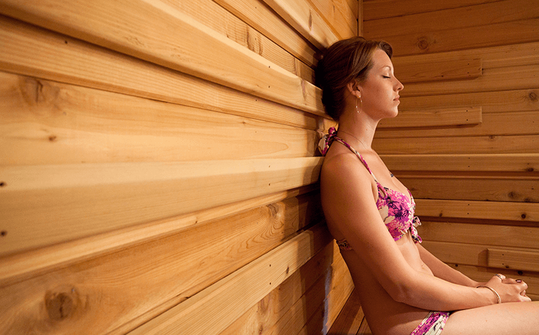 Image of woman in sauna for UK Saunas article on sauna etiquette.
